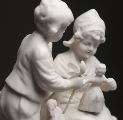 Figurine with Doll