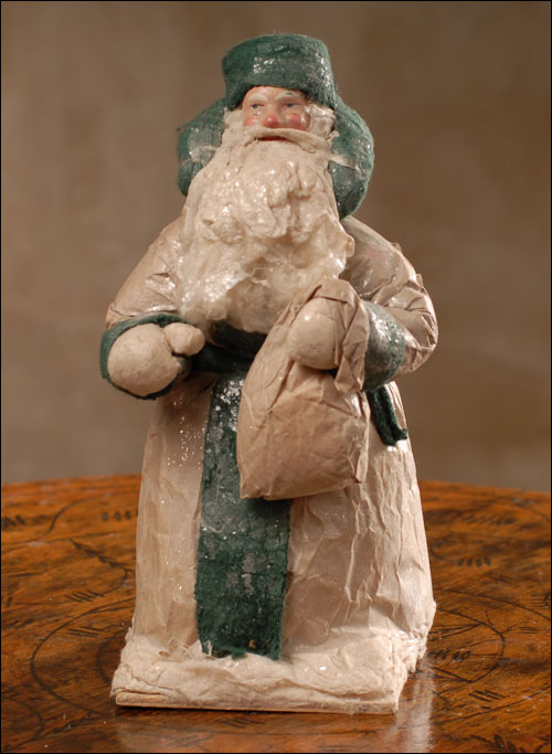 Antique Christmas cotton figure of Santa