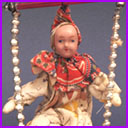 Antique Christmas ornament CLOWN on SWING