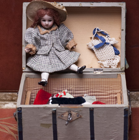 Antique Mignonette doll with her wardrobe