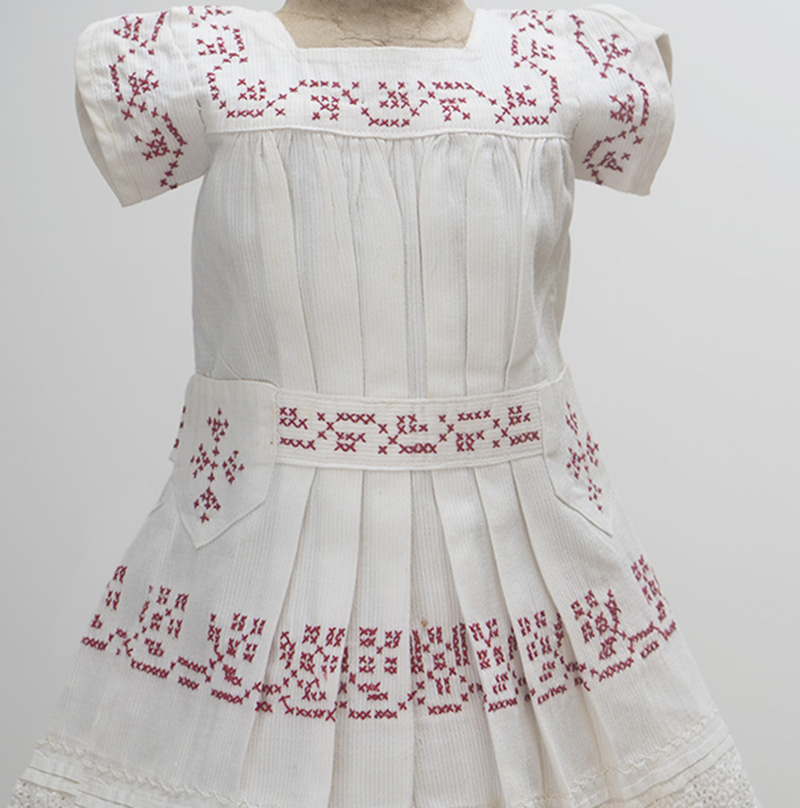 White Cambric Pinafore with res Cross-Stitch