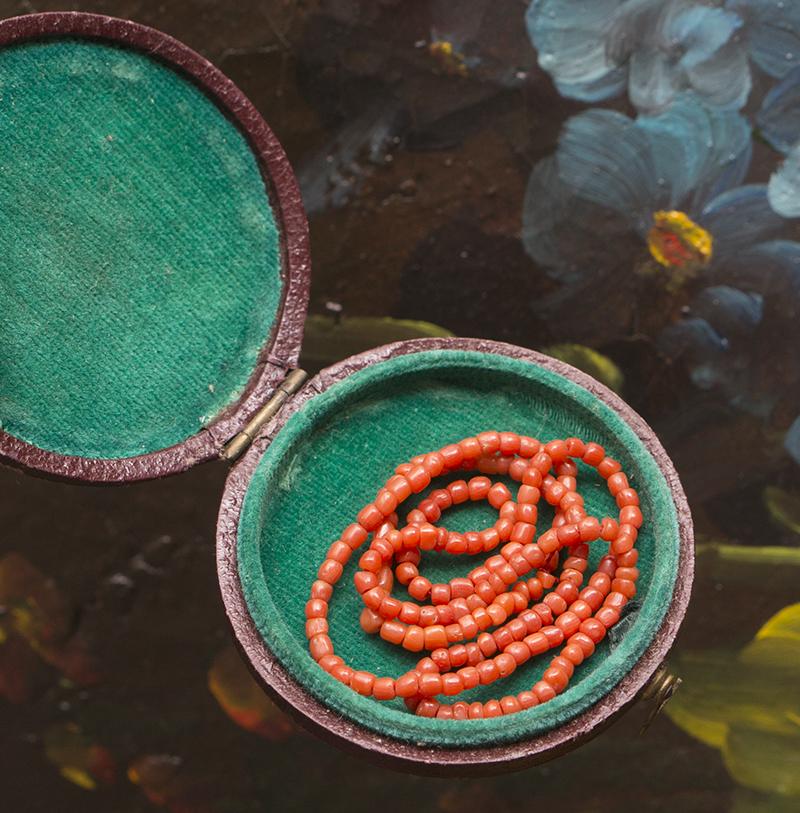 Antique doll coral beads neckline