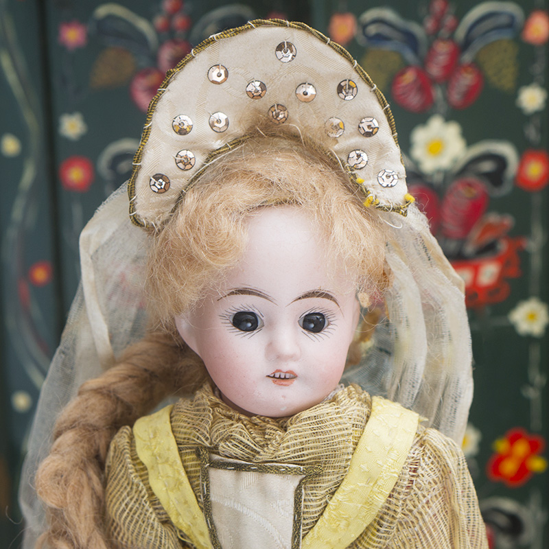 Antique doll in russian costume