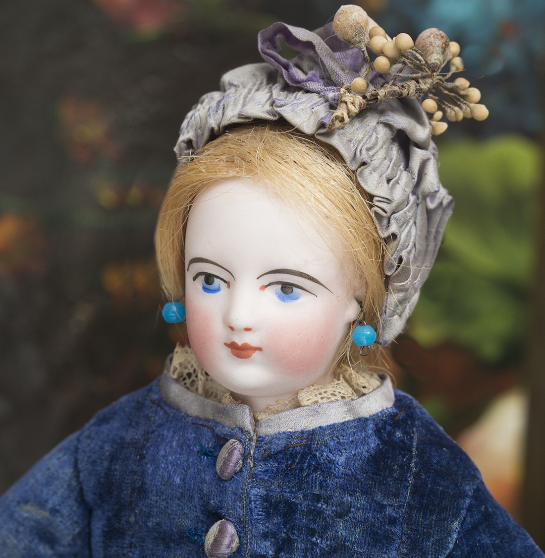 Small FG doll with painted eyes