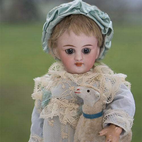 Tiny S&H doll with lamb