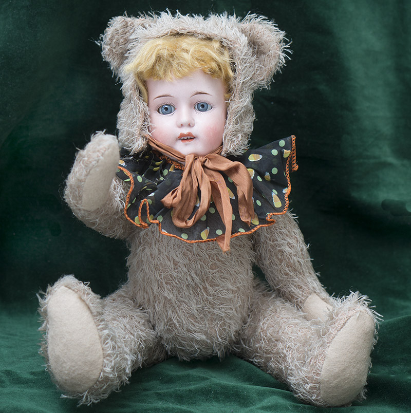 Antique Doll in Early mohair Teddy Bearsuit