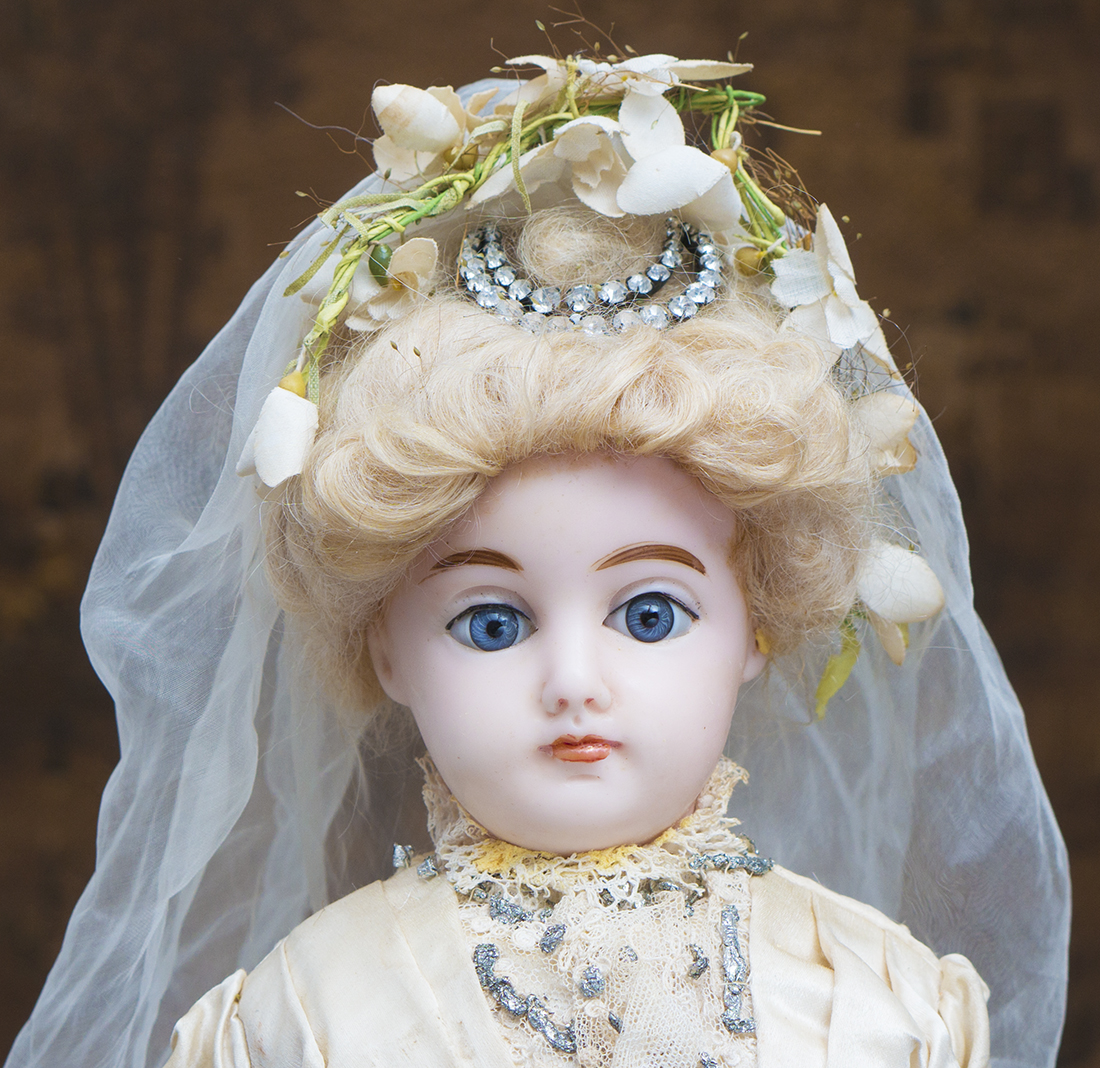 Antique Wax doll in wedding costume