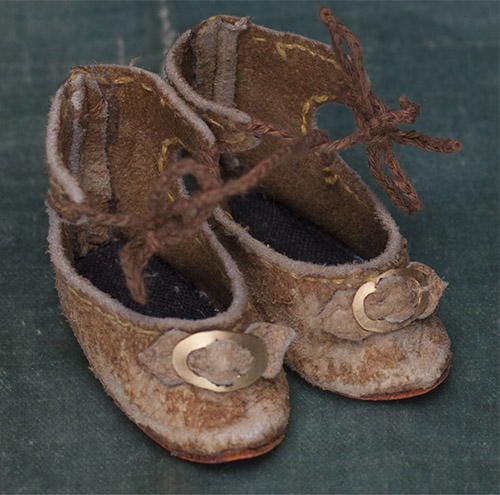 Antique small shoes for doll
