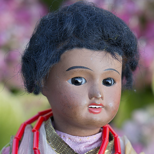 UNIS France small black doll