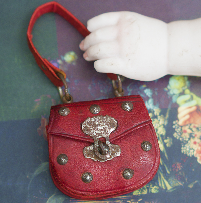 Antique doll red bag