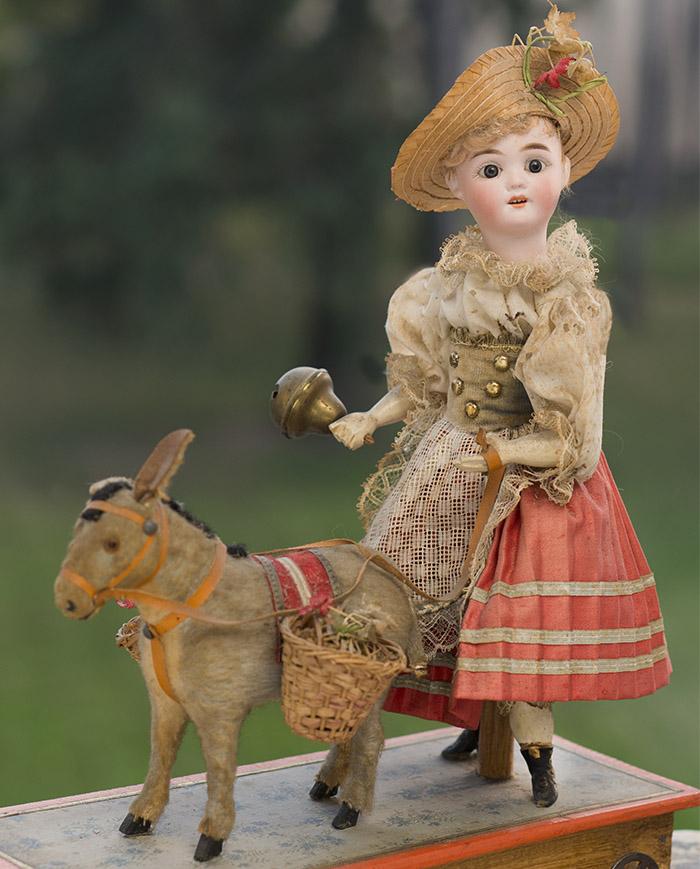 Немецкая механическая игрушка Кукла с осликом