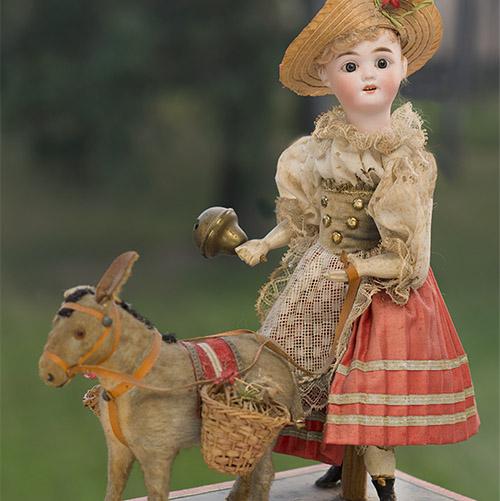 Механическая игрушка Кукла с осликом