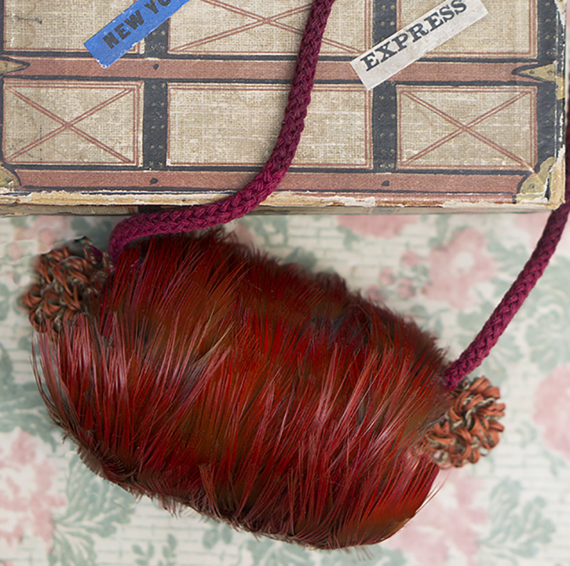 Red feather muff in box